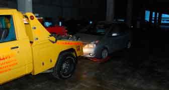 Эвакуация автомобиля - восьмой этаж гаража.